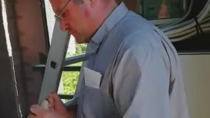 don Stefano ad Andora sulla torre del campanile